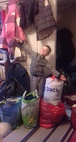 7 year old Owen, collects Coats4Calais!