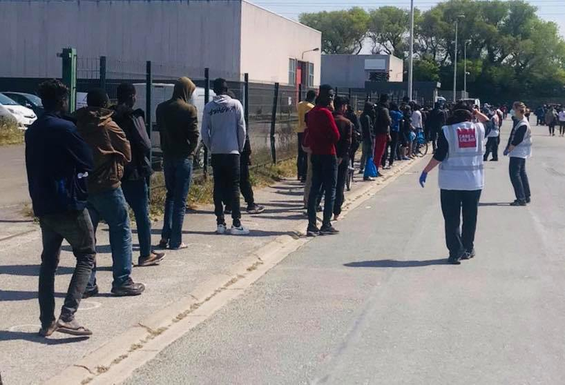 Smiles abound as 200 brand-new joggers distributed in Calais