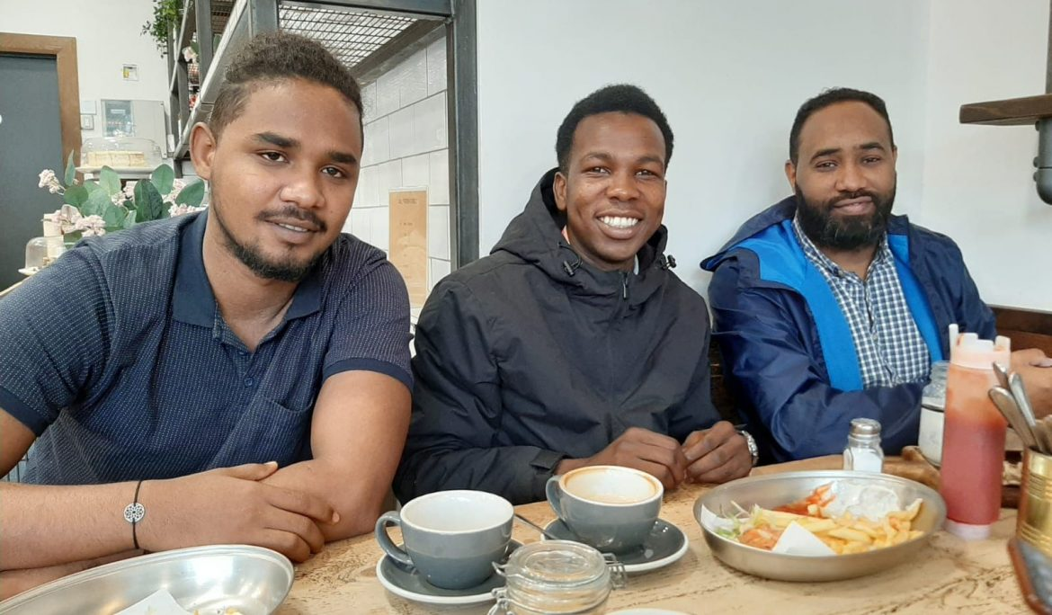In remote barracks, refugees make their own community