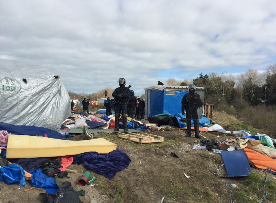 Riot police 'slash tents and take everything away'