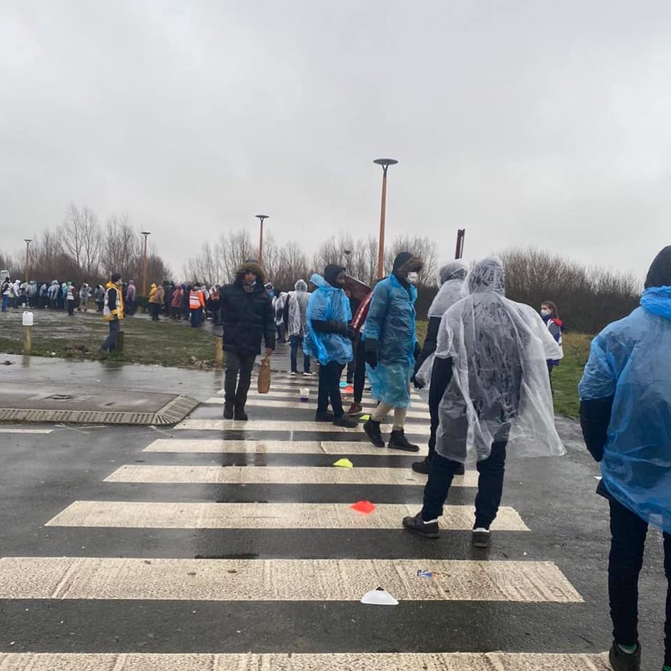 Over 200 pairs of new shoes distributed in waterlogged Calais